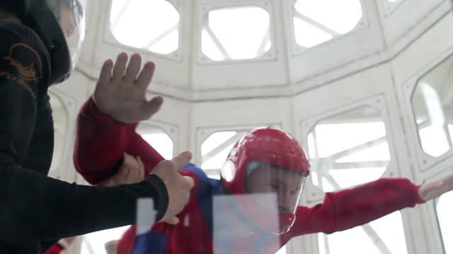Man with an instructor in a wind tunnel video