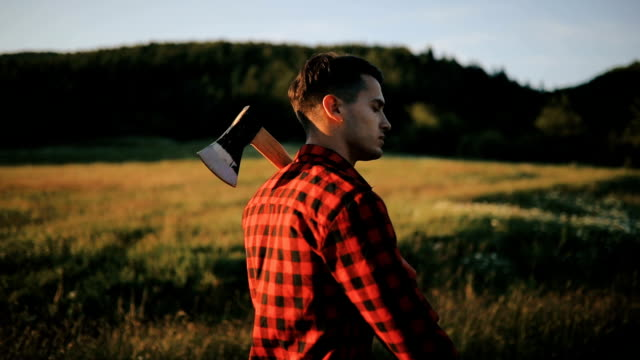 Man with axe in the forest video