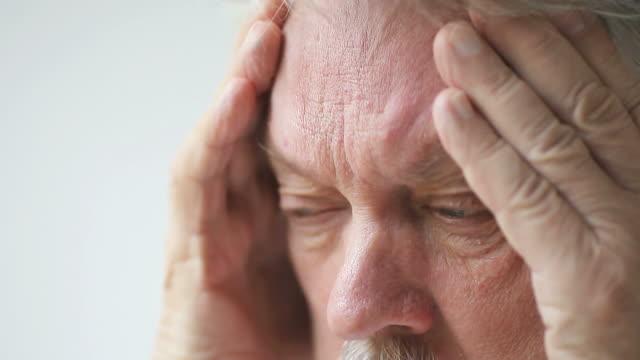 man with bad headache video