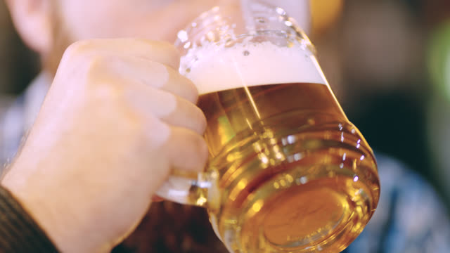 ecu man with beard drinking a beer in the pub - baffo peluria del viso video stock e b–roll