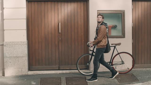 Man with bike on sidewalk video