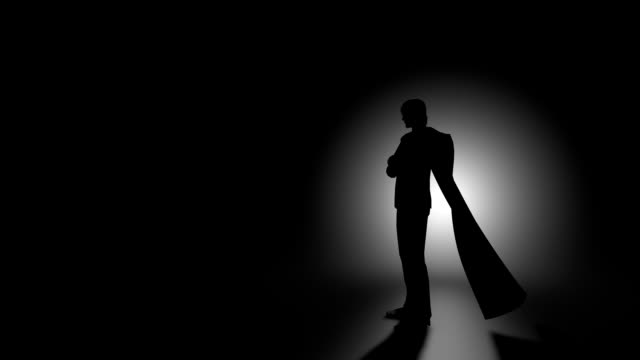 Man with billowing cloak Man standing in front of light. 3D animation. cape garment stock videos & royalty-free footage