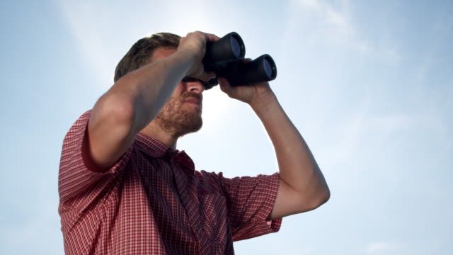 Man with binoculars video