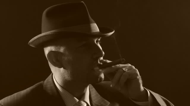 Man with bowler hat and cigar