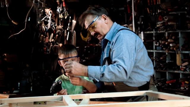 Man with boy making window video