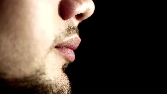 Man with braces on teeth black background. Macro lens. video