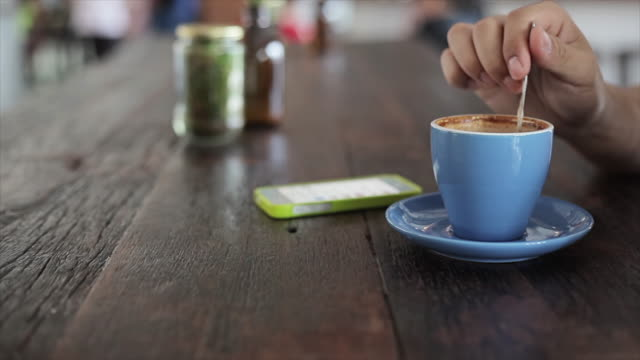 Man with cup of drinking coffee at cafe restaurant video