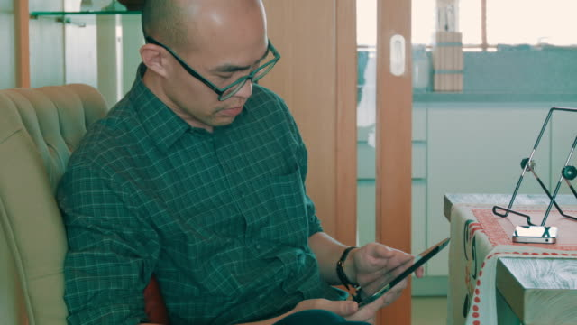 Man with digital tablet video