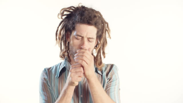 Man with dreadlocks smoking medicinal marijuana on white background Man with dreadlocks smoking medicinal marijuana on white background hashish stock videos & royalty-free footage