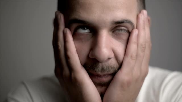 Man with facial tics video