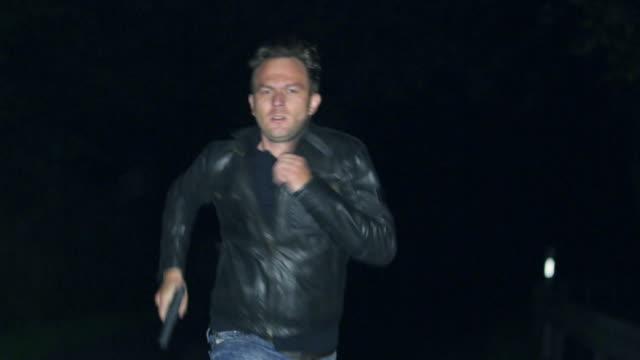 Man with gun running on street video