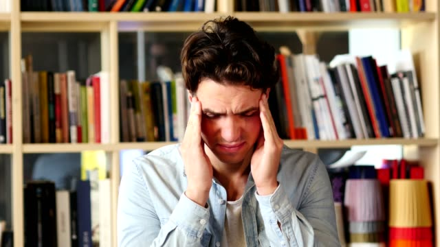 man with headache, frustration and tension - состаривание стоковые видео и кадры b-roll
