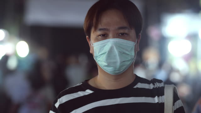 a man with hygienic mask - virus protection video stock e b–roll