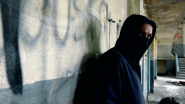 Man With Mask And Hoodie Looking At The Camera