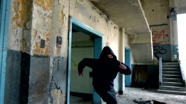 Man With Mask And Hoodie Running Toward The Camera