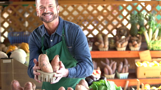 Man working at produce stand video