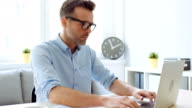 istock Man working from home office on laptop 1159385646