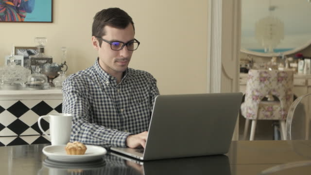 Man Working from Home with Laptop video