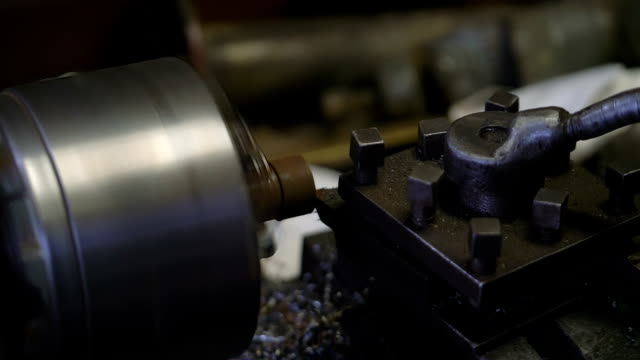 Man working in a workshop on lathe in slow motion video