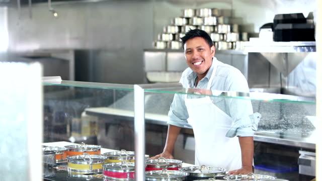 man working in restaurant serving food - филиппинского происхождения стоковые видео и кадры b-roll