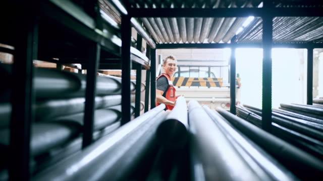 man working in tubing warehouse - нержавеющая сталь стоковые видео и кадры b-roll