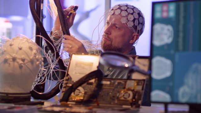 Man working on Brainwave Scanning Headset
