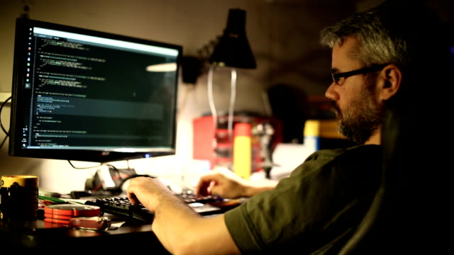 Man working on computer video