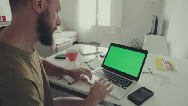 Man working on laptop at home video