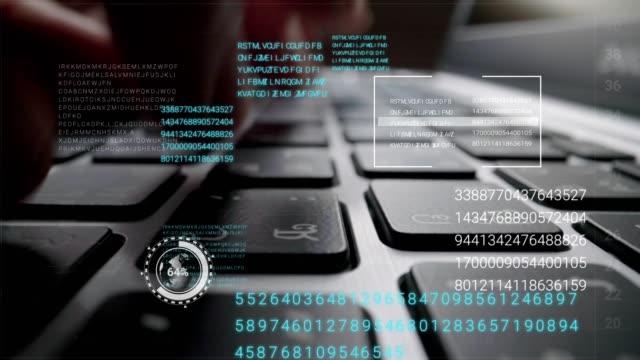 man working on laptop computer keyboard with graphic user interface gui hologram - безопасность сети стоковые видео и кадры b-roll