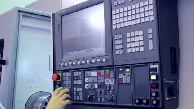 Man working on the control panel works with an industrial machine close-up. Man working on the control panel works with an industrial machine at the factory close-up. Industrial machinery, production aggregation and equipment mechanical automaton. Heavy machinery manufacturing equipment stock videos & royalty-free footage