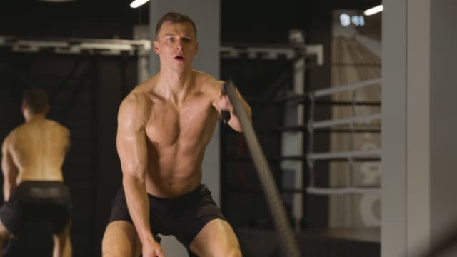 Man working out with ropes video