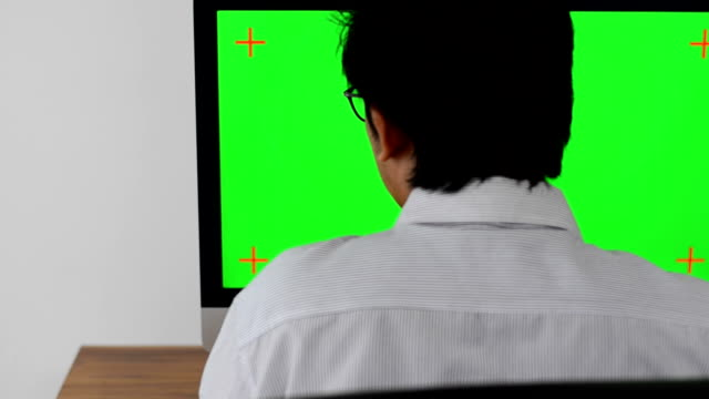 Man working with computer green screen video