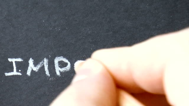 man writes a white pencil word impossible video