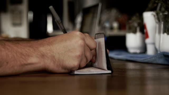 Man writes check at home 4k video