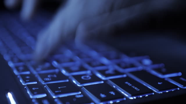 Man Writes Message to Social Network. Computer Hacker Typing Code Virus PC on Keyboard Late Night Working. Journalist Writes Article in Media. Working on Laptop, Typing on Keyboard, Modern Business.