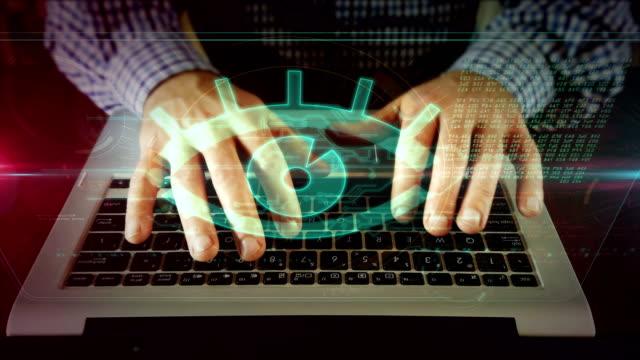 man writing on laptop keyboard with spy eye - идентификация личности стоковые видео и кадры b-roll