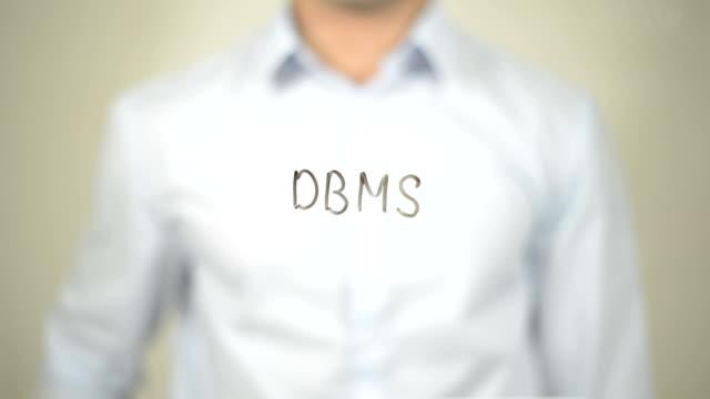 DBMS, Man writing on transparent screen