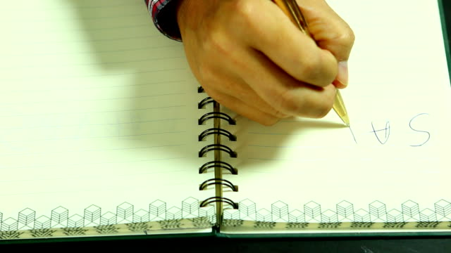 man writing save earth word, on the book - earth day stock videos and b-roll footage