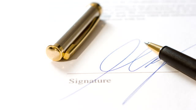Man writing signature and pen video