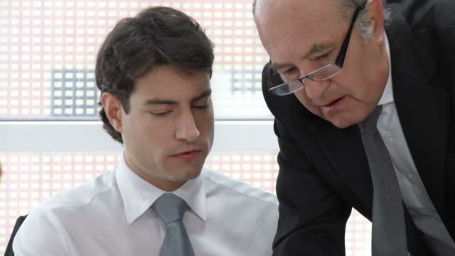 HD: Manager Assisting Young Office Worker video