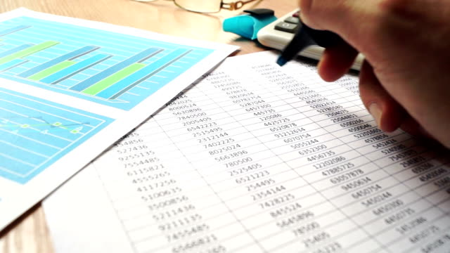 Manager checking financial report and work with papers. video