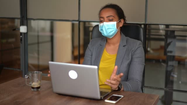 hr manager conducting job interview with candidate on video call during covid-19 pandemic - video di protezione video stock e b–roll
