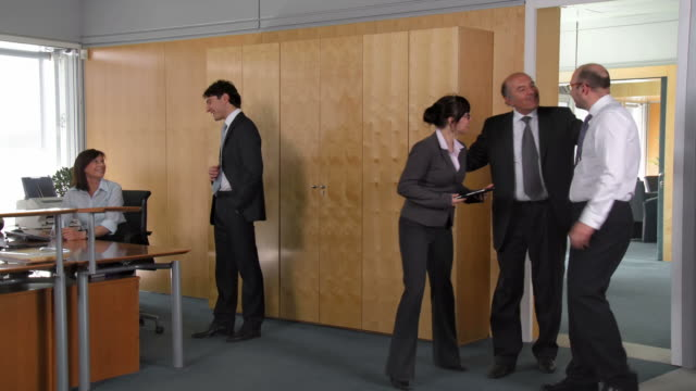 HD: Manager Giving A Friendly Reception To His Business Partner video