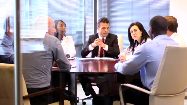 manager leads a meeting with medical professionals - ws - manager stock videos and b-roll footage