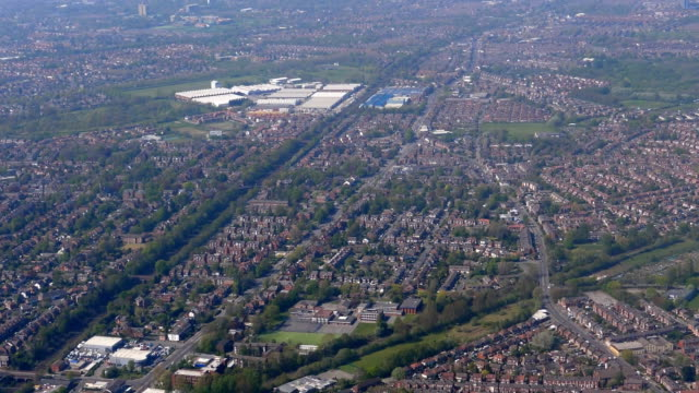 manchester aerial view between industrial site in reddish and road a5145 - manchester inghilterra video stock e b–roll