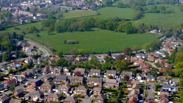 Manchester aerial view from Gatley golf course to road A555 by airport field