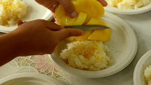 Mango and sticky rice for meeting Mango and sticky rice for meeting. mango stock videos & royalty-free footage