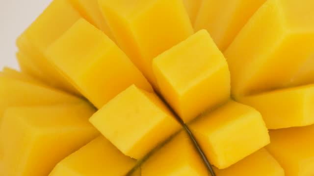 Mango close up rotating. Fruit tropical. Loop. Mango close up rotating. Fruit tropical. Loop. mango stock videos & royalty-free footage