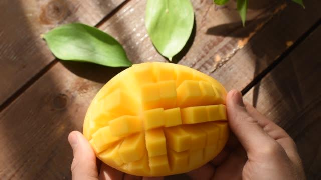 Mango Cut Open Closeup View Mango Cut Open By Male Hands, Closeup View. Exotic Tropical Juicy Ripe Fruit mango stock videos & royalty-free footage