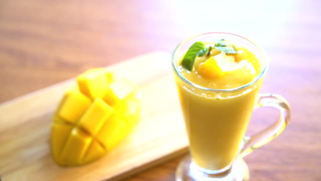 mango smoothie mango smoothie mango stock videos & royalty-free footage